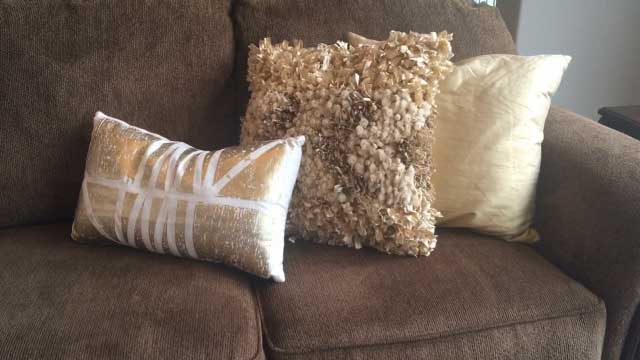 Sally Moore Home Staging lighten a room with pillows